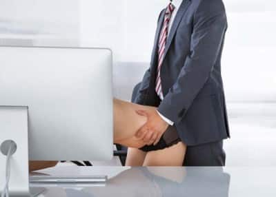 Portrait of a couple having sex in office